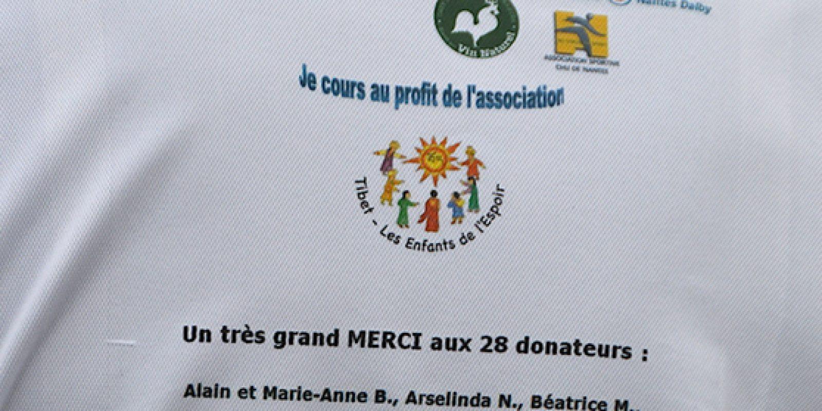 Philippe Bouron de dos, avec son tee-shirt de course au logo de T.E.E Imprimé  (15 février 2015)